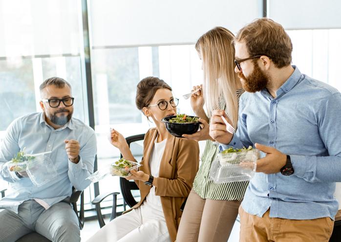 team collaboratinig over snacks
